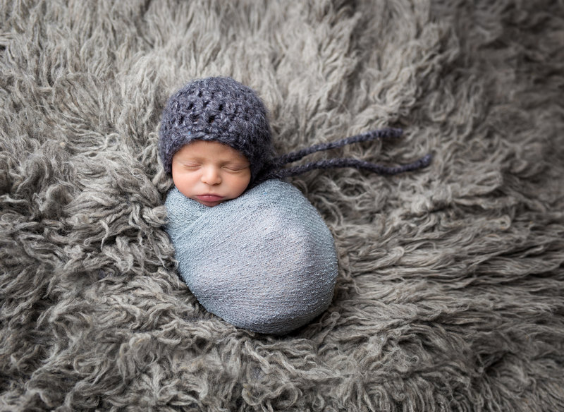 baby wrapped blue and grey flokati
