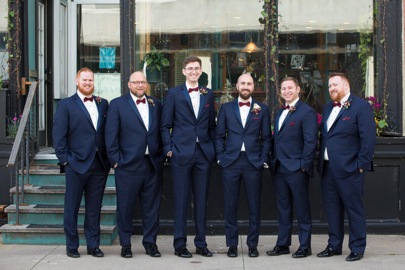 groomsmen in navy suits outside of cityflats ballroom port huron michigan