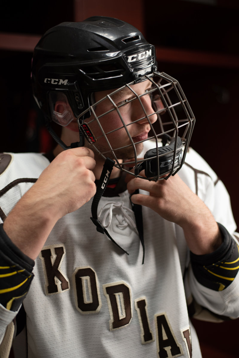 Senior guy in hockey jersey and face mask
