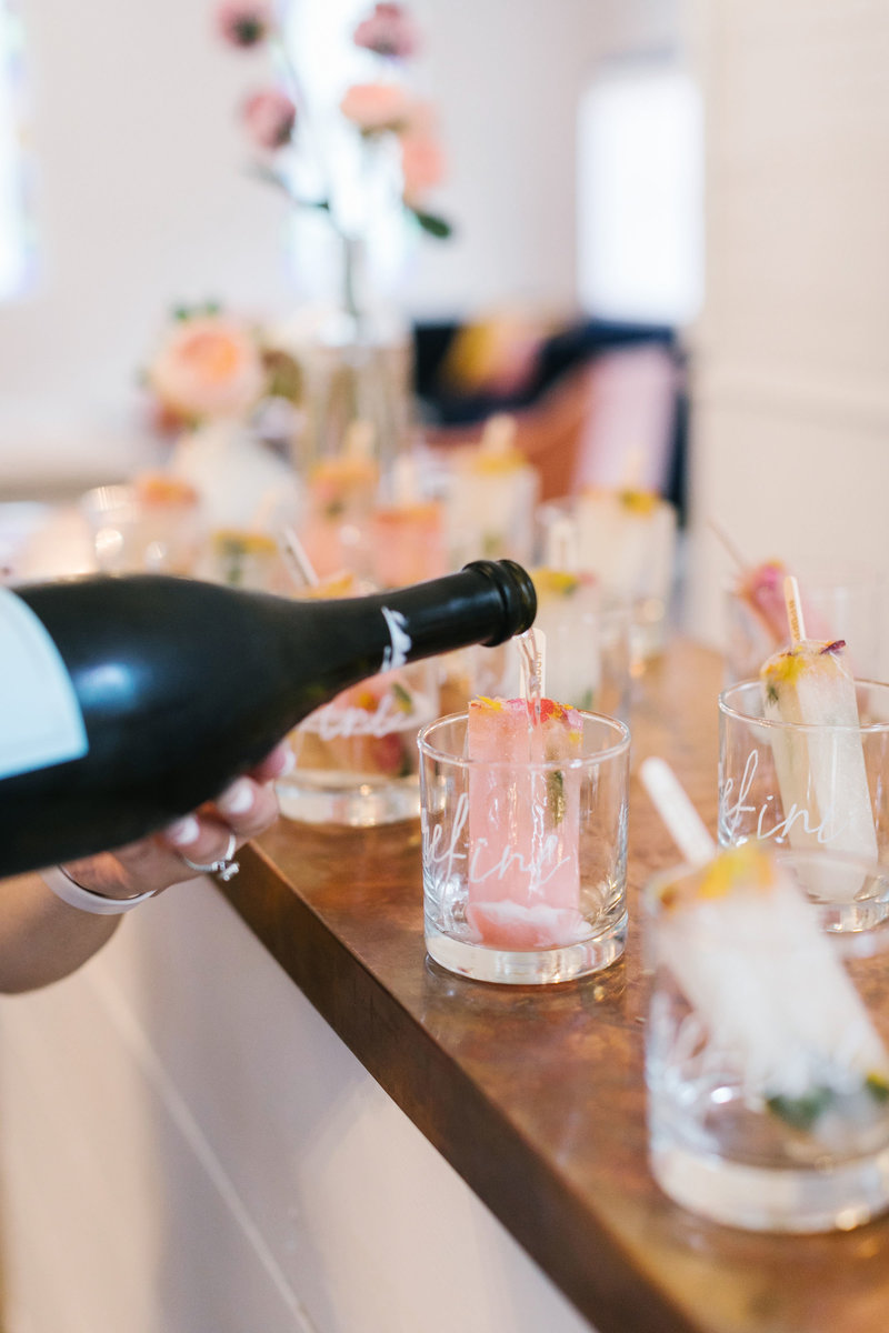 Champagne being poured into cocktails at Refine Retreat for Wedding Planners
