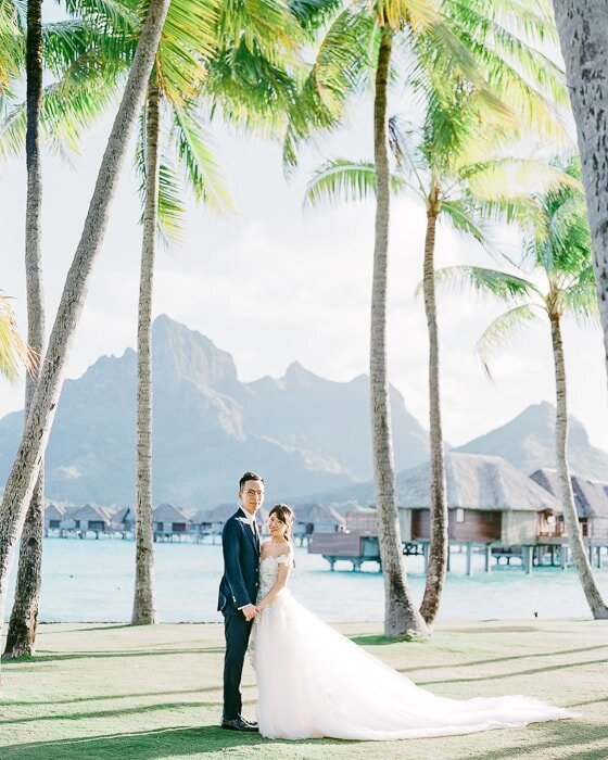 Elegant Wedding at the Four Seasons Resort Bora Bora, bride and groom photoshoot in front of the Mount Otemanu