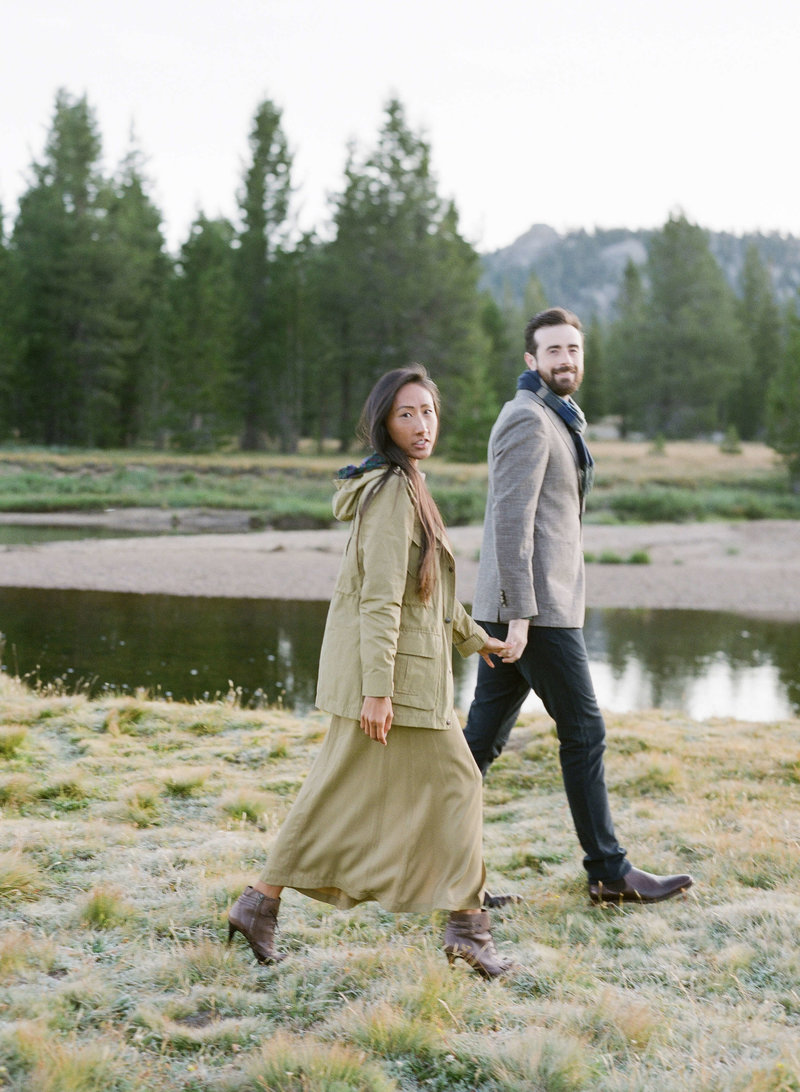 12-KTMerry-destination-engagement-photography-couple-walking-Yosemite