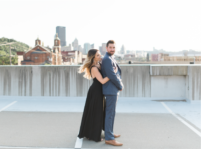 Couple on rooftop in Pittsburgh engagement photos