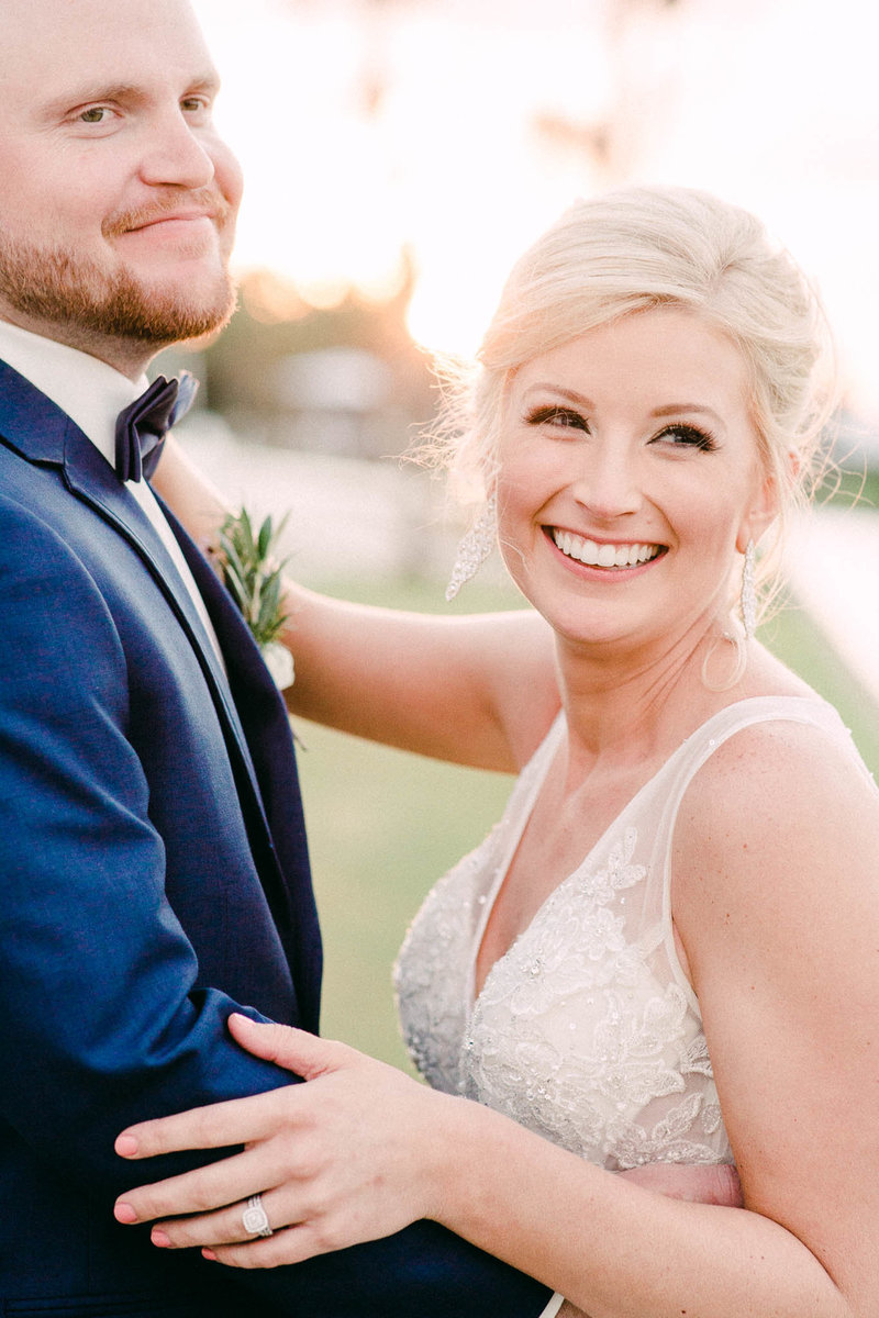 Sunset portraits by the water at Plantation Inn Wedding