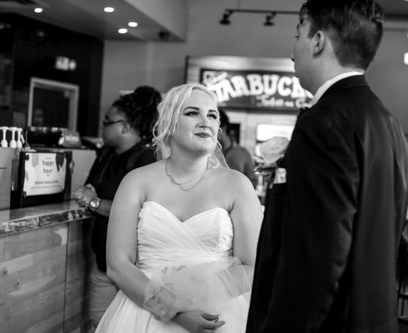 Bride and groom make a Starbucks run between their Phipps Conservatory wedding and reception in Pittsburgh, PA