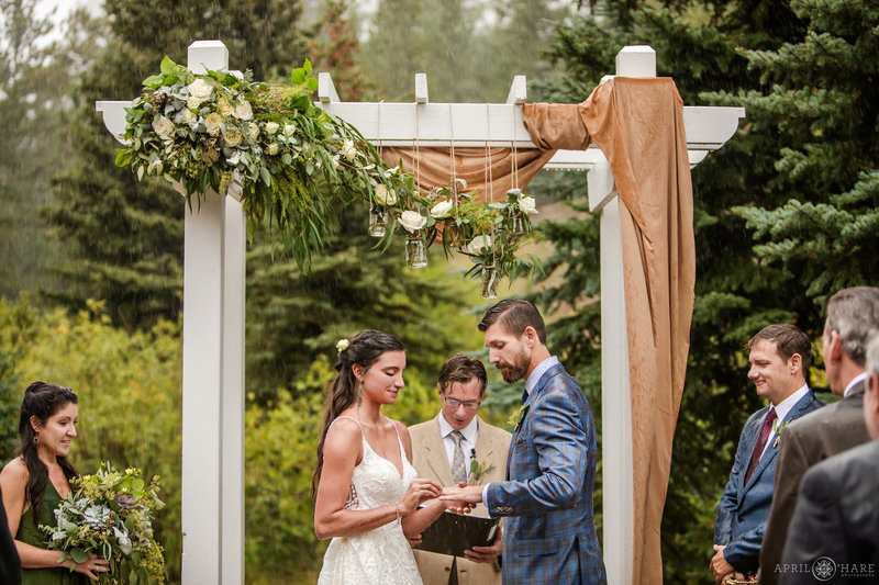 Couple Gets Married Outside in the Pouring Rain at a Rustic Colorado Mountain Wedding Venue