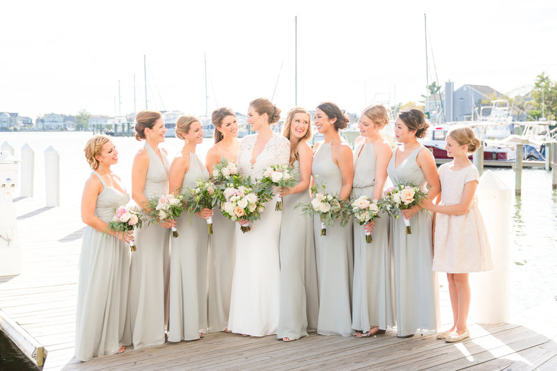 Bridesmaids wearing soft green dresses