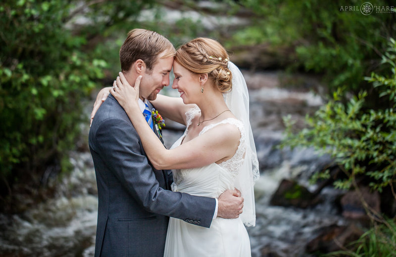 Pretty mountain stream backdrop of Elk Creek in Pine CO Wedding Photography