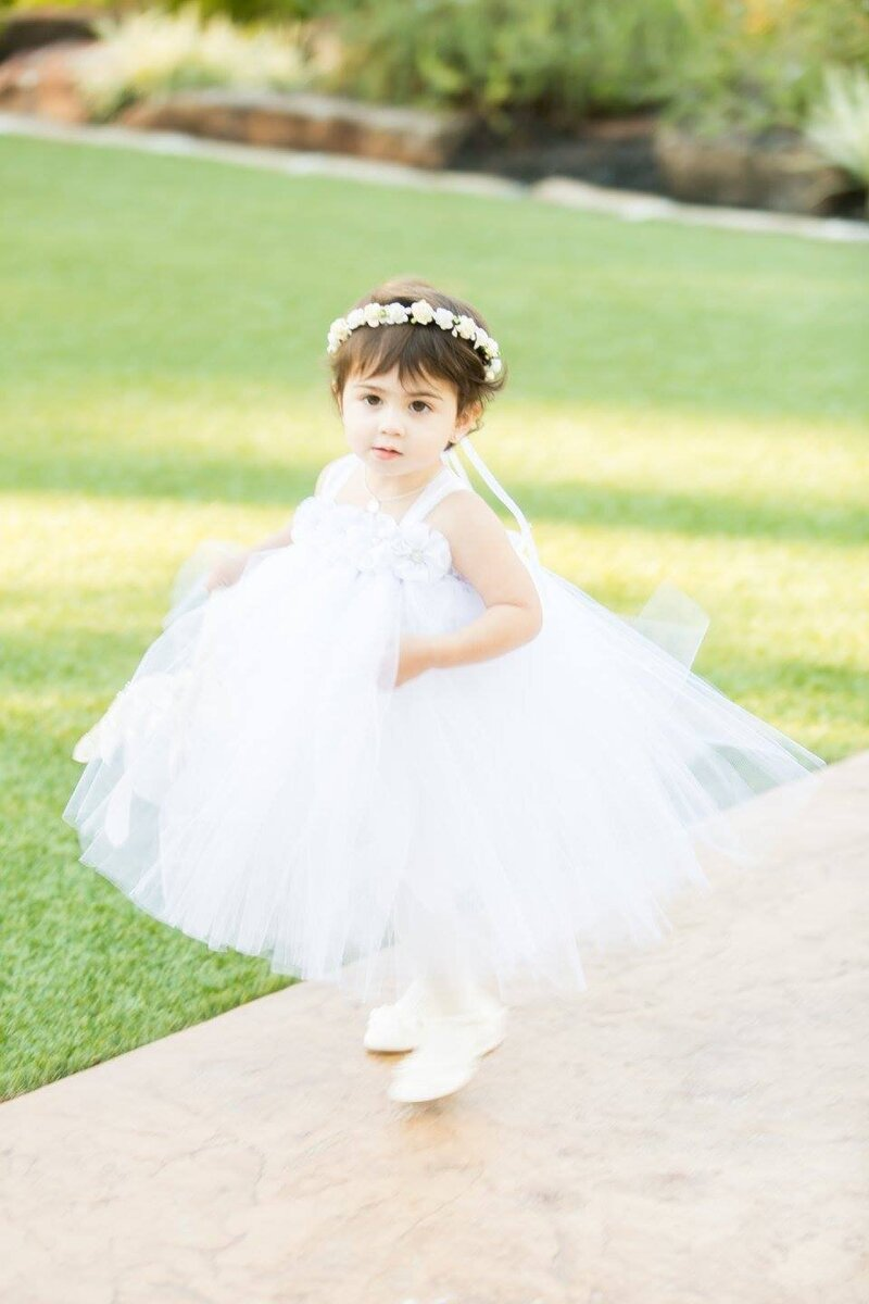 fluffy lace flower girl dress on a flower girl