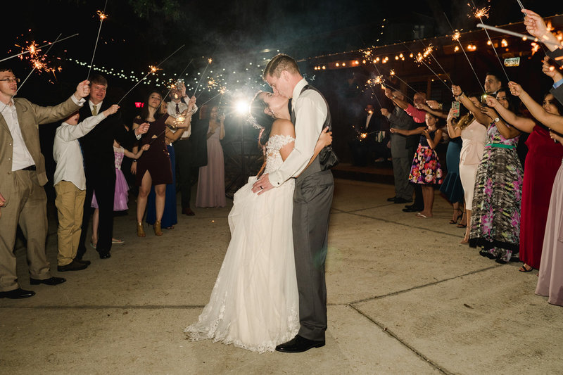 Bride and groom kissing at their sparkler exit at Club Lake Plantation