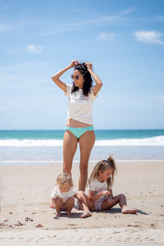 Mother at beach with children
