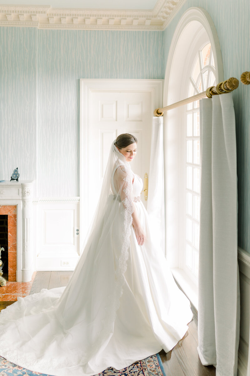 Virginia Wedding Photographer, bride standing next to window