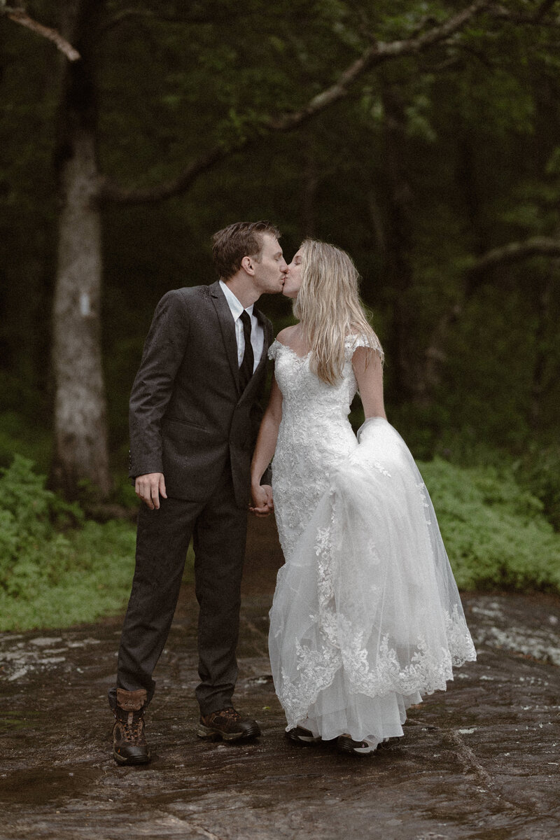 Couple kissing in wedding attire on the Appalachian Trail