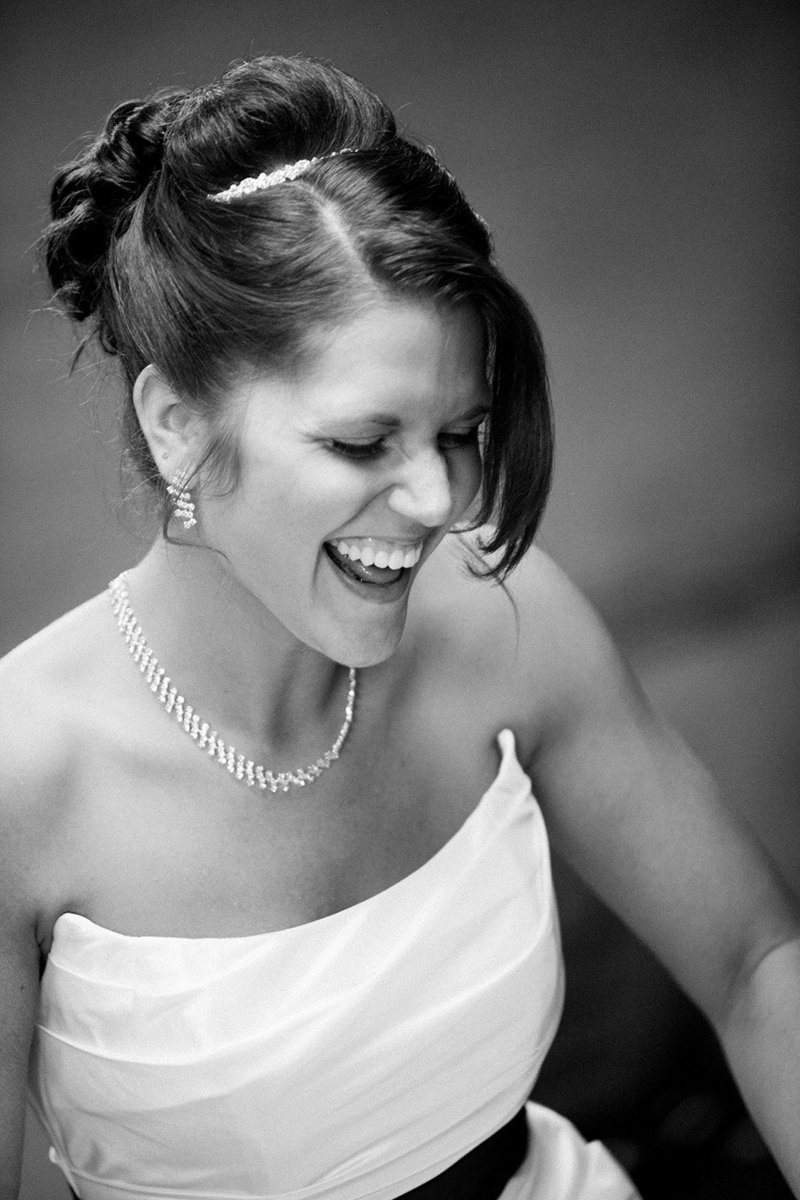Bride laughing during getting ready pictures