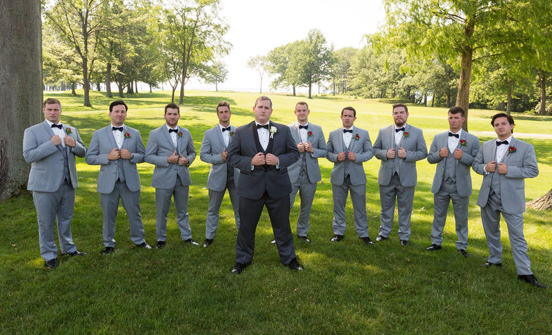 Groom with his groomsmen at Lawrence Park golf club