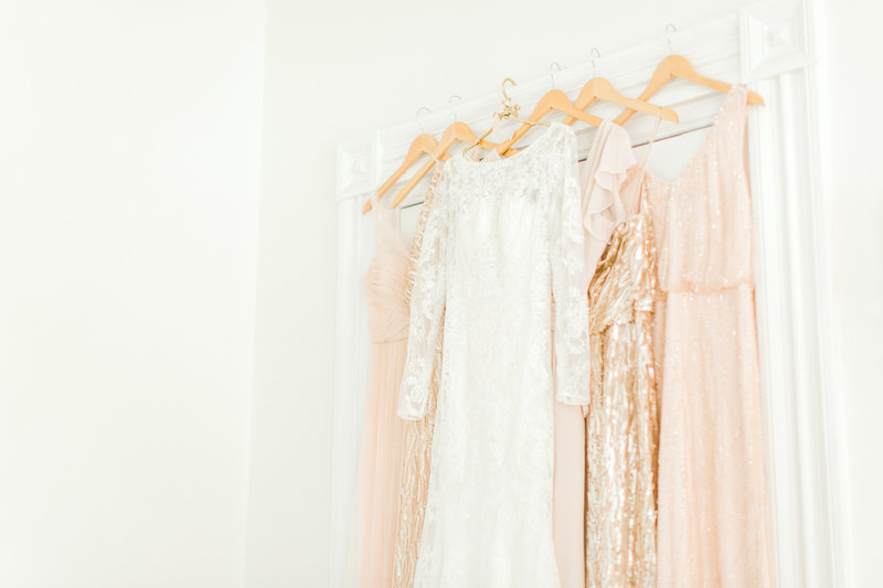 bhldn dresses hanging on wall