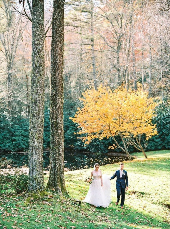 newlyweds walking through forest