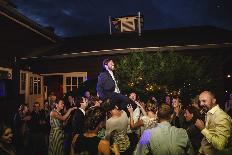 groom lifted on chair horah dance at wedding receptino at Jenkins Estate in Oregon