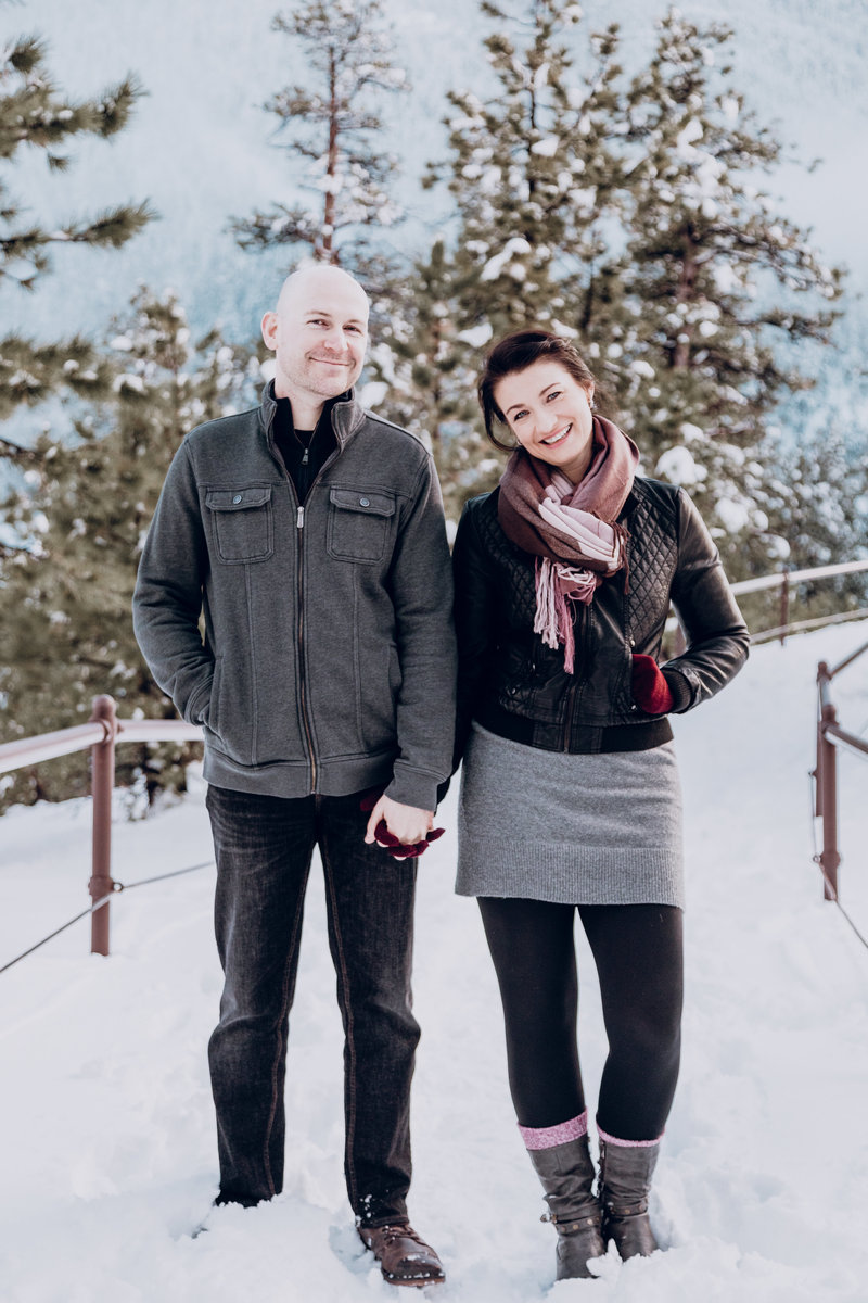 tahoe engagement pictures couple poses on snowy path