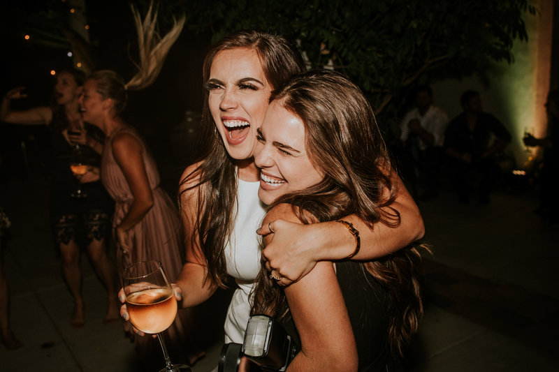 girls laughing at party