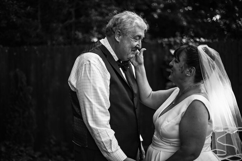 First look between bride and groom before intimate garden wedding in Erie, PA