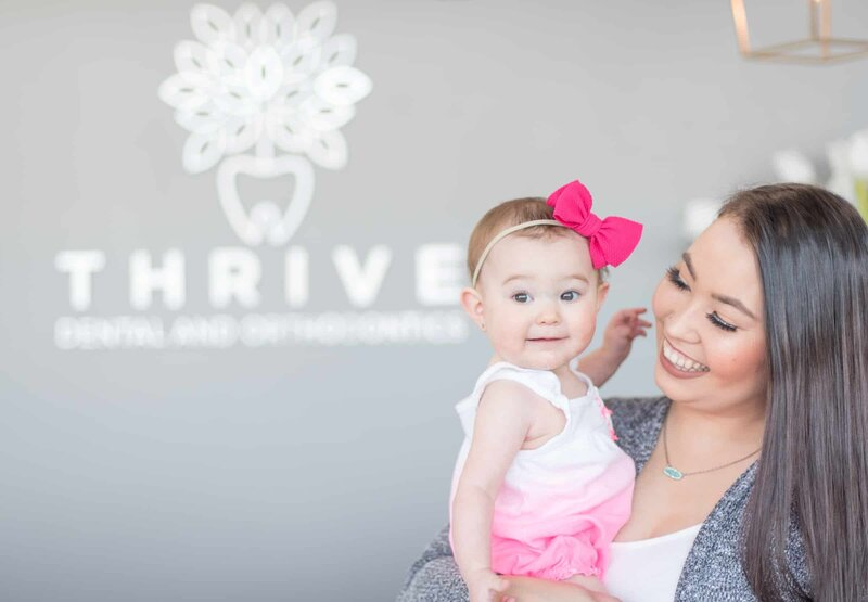 Baby with Mom at Thrive Dental Dallas TX