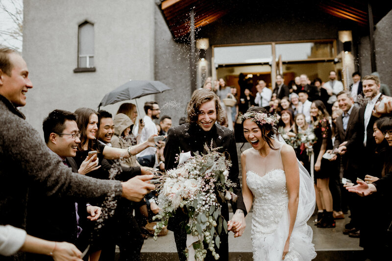 Daisy and Jeremy happily walking out of their church wedding