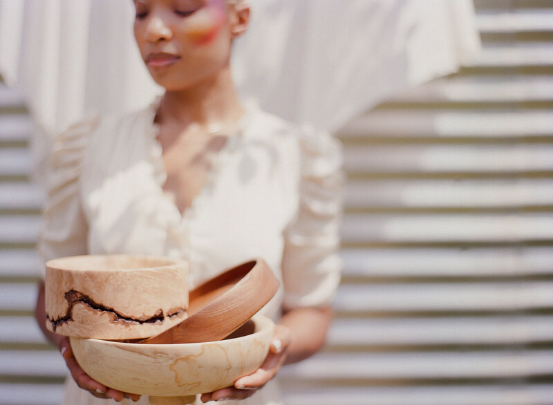 Woman holding handcrafted wooden bowls