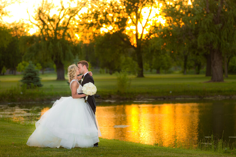 A sunset wedding photo taken next to a lake in Wicker Park.