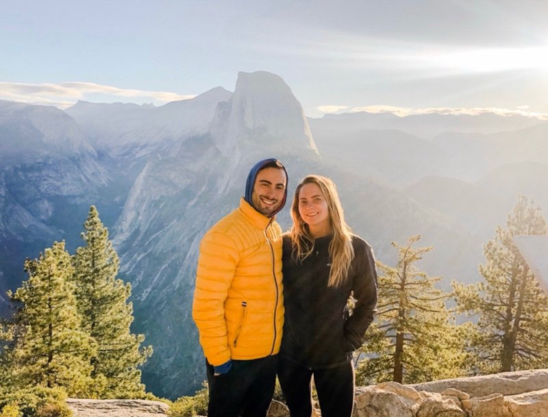 bree and stephen smiling at the camera while working an elopement at yosemite national park