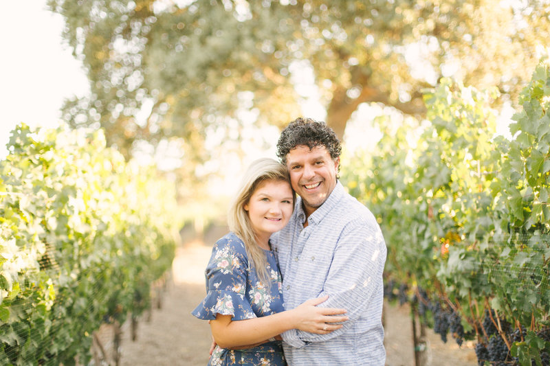 Bride and groom embrace at Roblar winery during engagement shoot