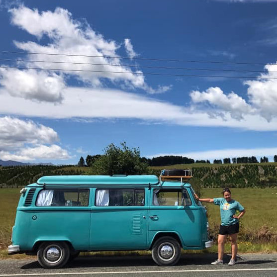 Akanesi standing beside kombi van Rhonda on roadside in Southland, New Zealand