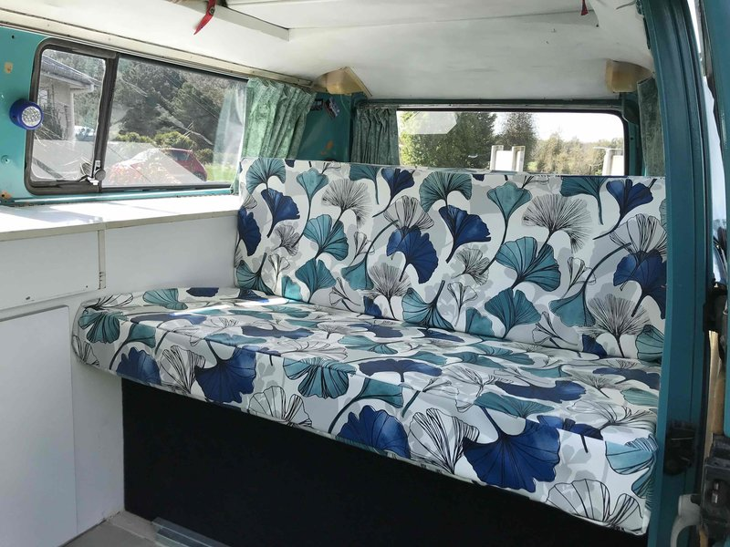 Inside view of seating of Rhonda, teal retro kombi van from NZ Kombi Hire