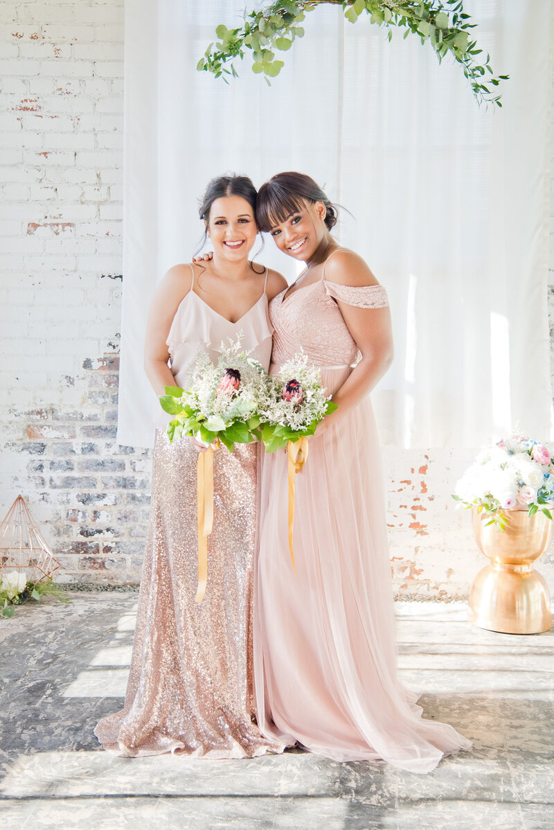 Bridesmaids with sparkling dresses and colorful bouquets in Fort Worth