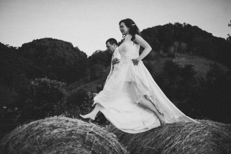 bride-jump-haybales-farm-wedding-photographer