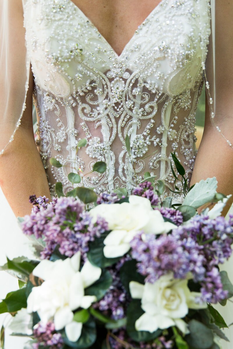 close up of dress and flowers