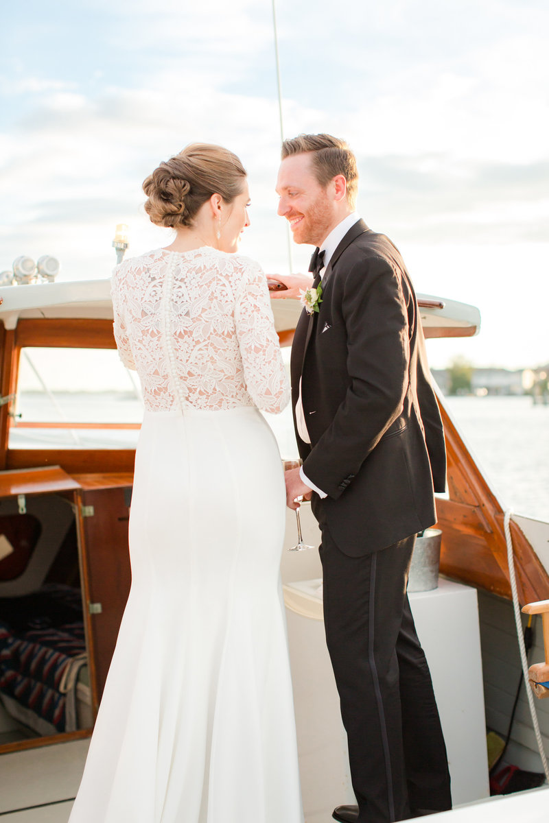 Bride and groom sharing a private moment on a boat