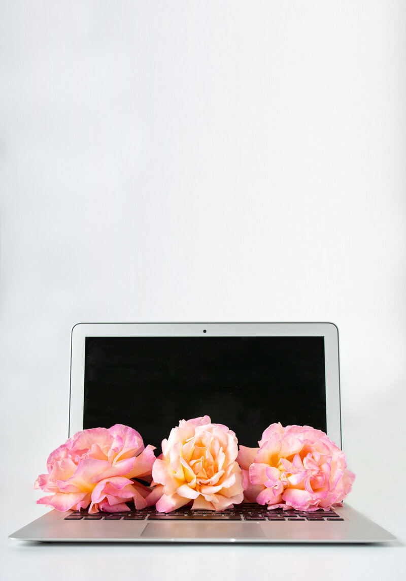 Open_laptop_flowers_full_vertical