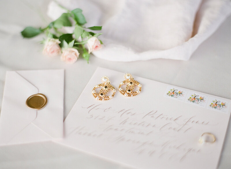 Details earrings love letter stationery and flowers