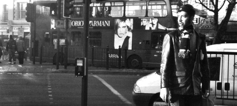 film photography from london with a man and a double decker bus