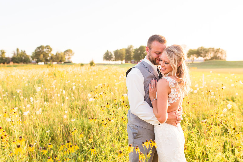 Bride and Groom Portraits in a field of flowers| Megan Snitker Photography | Iowa City Wedding Photographers