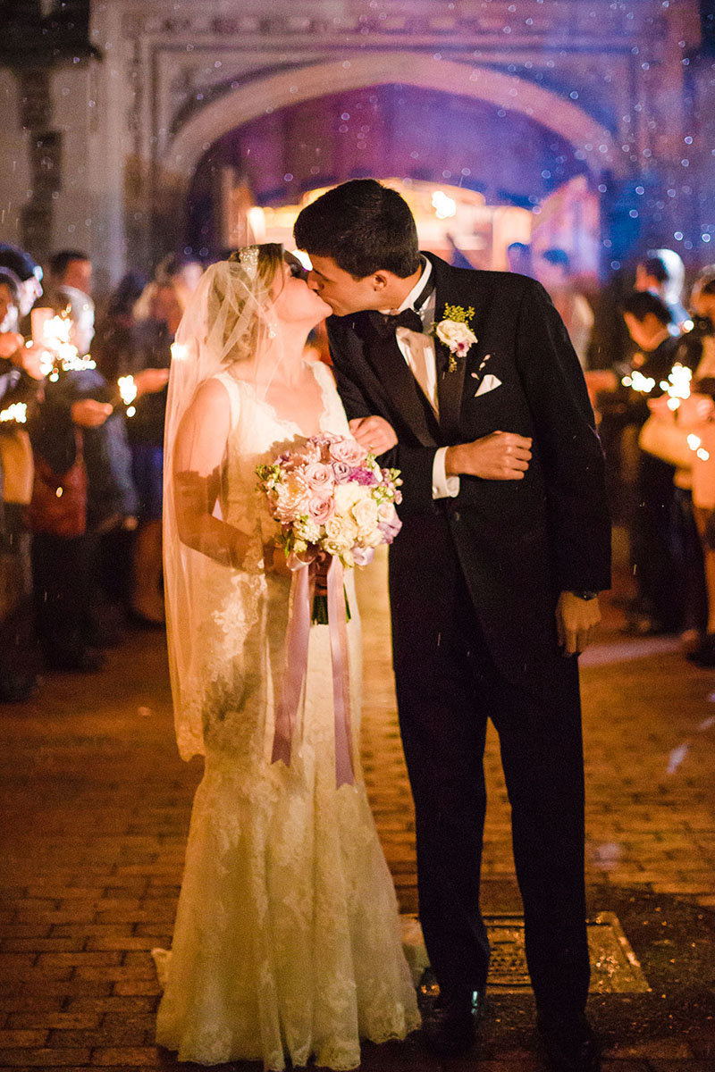 evening wedding ceremony at graham chapel with sparklers in st louis missouri