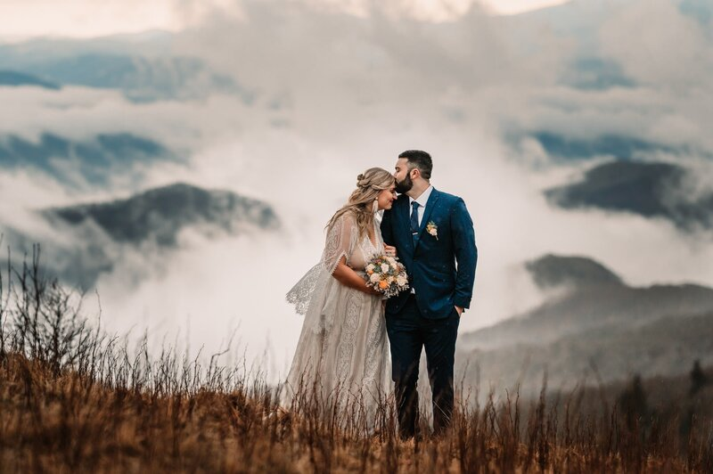small wedding with multi colored flowers and a stormy background photographer