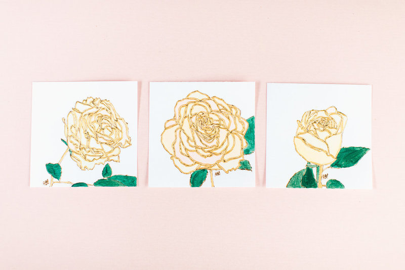 set of three yellow single flowers wood burned on paper