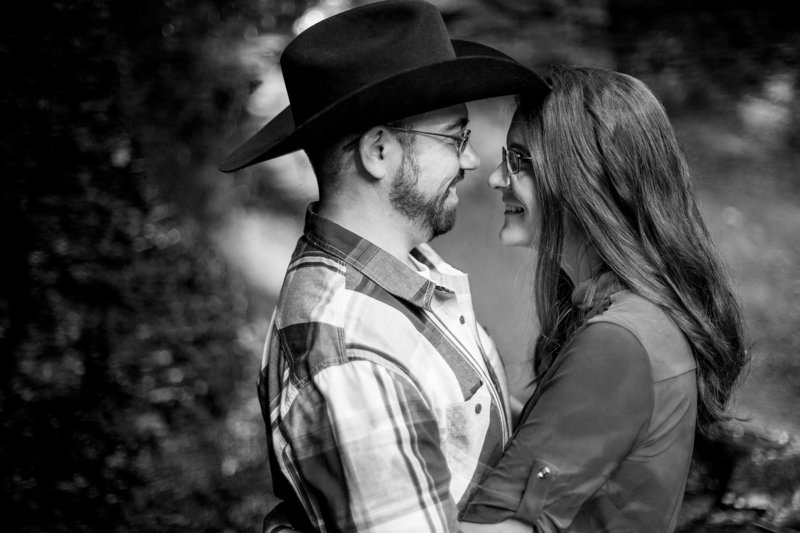 Engaged couple embrace for engagement photos at Linn Run State Park