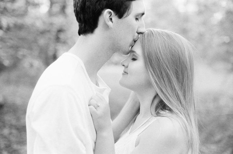 husband and wife kissing by hampton roads virginia wedding photographer