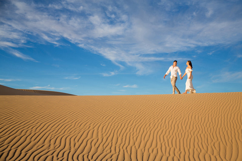 Wedding Couple Walking on Giant Sand Dunes in Glamis