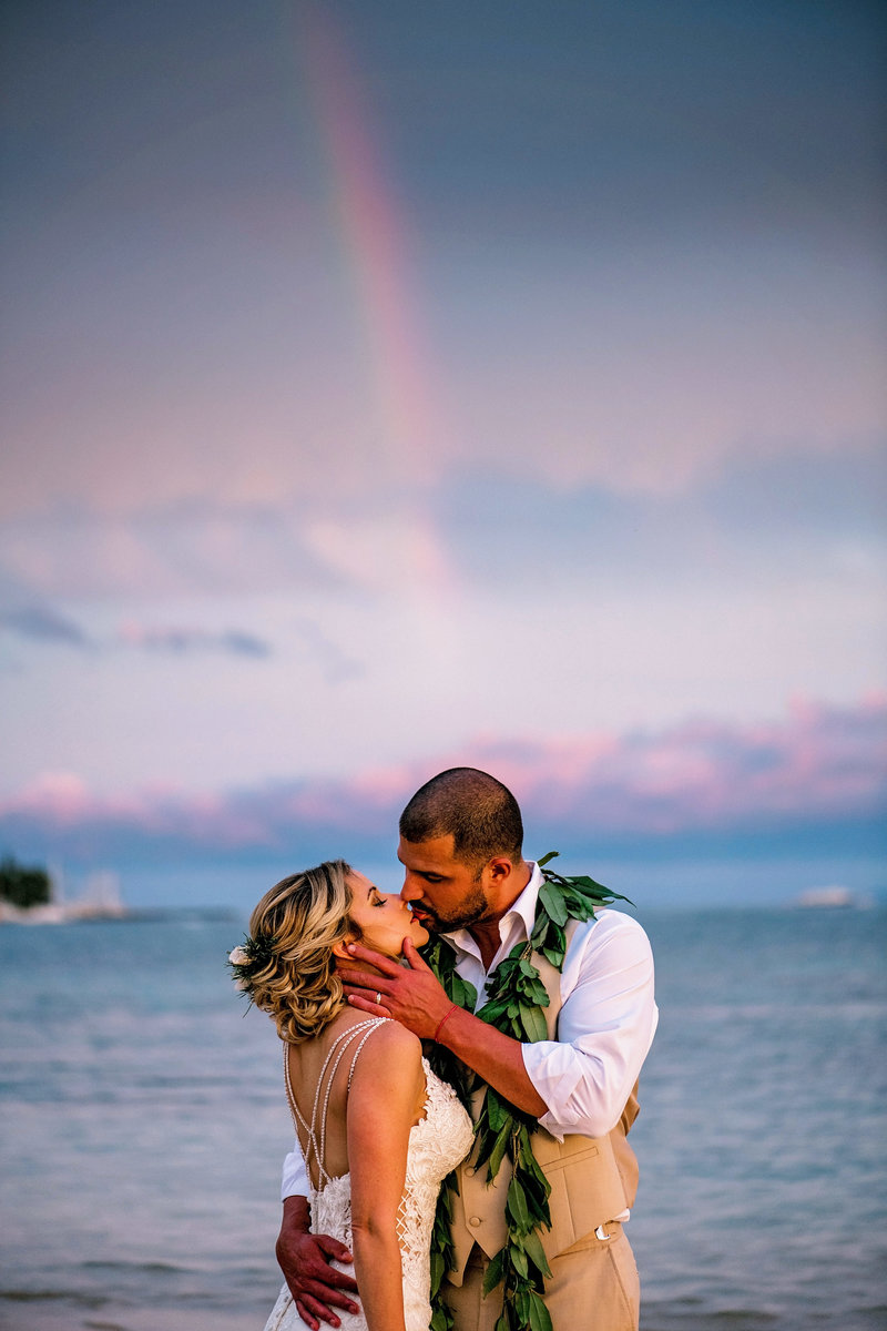 Couple kiss under a rainbow in Lahaina Maui