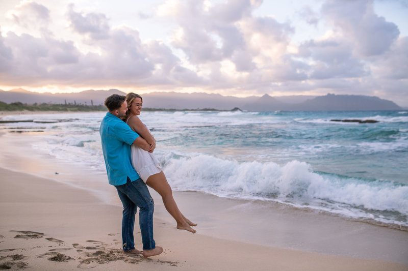 Couples Photography Oahu Hawaii,  man picking up woman at the beach