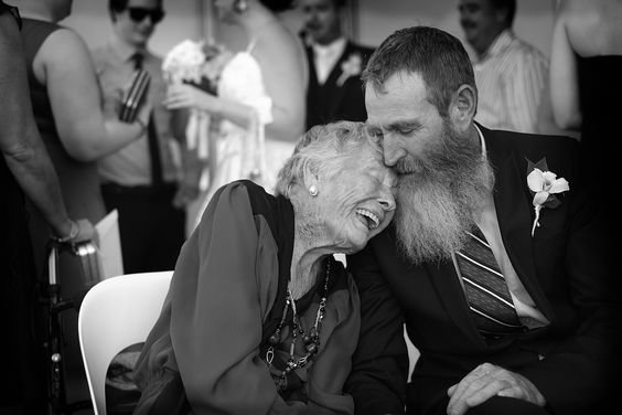 A mother and son embrace at a Gold Coast wedding